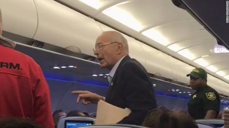 Social media video shows former New York Senator Al D'Amato being kicked off the flight