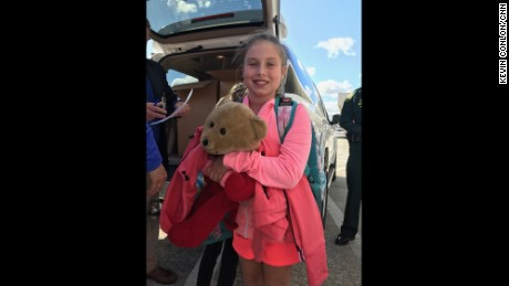 Courtney Gelinas and her beloved teddy bear, Rufus.