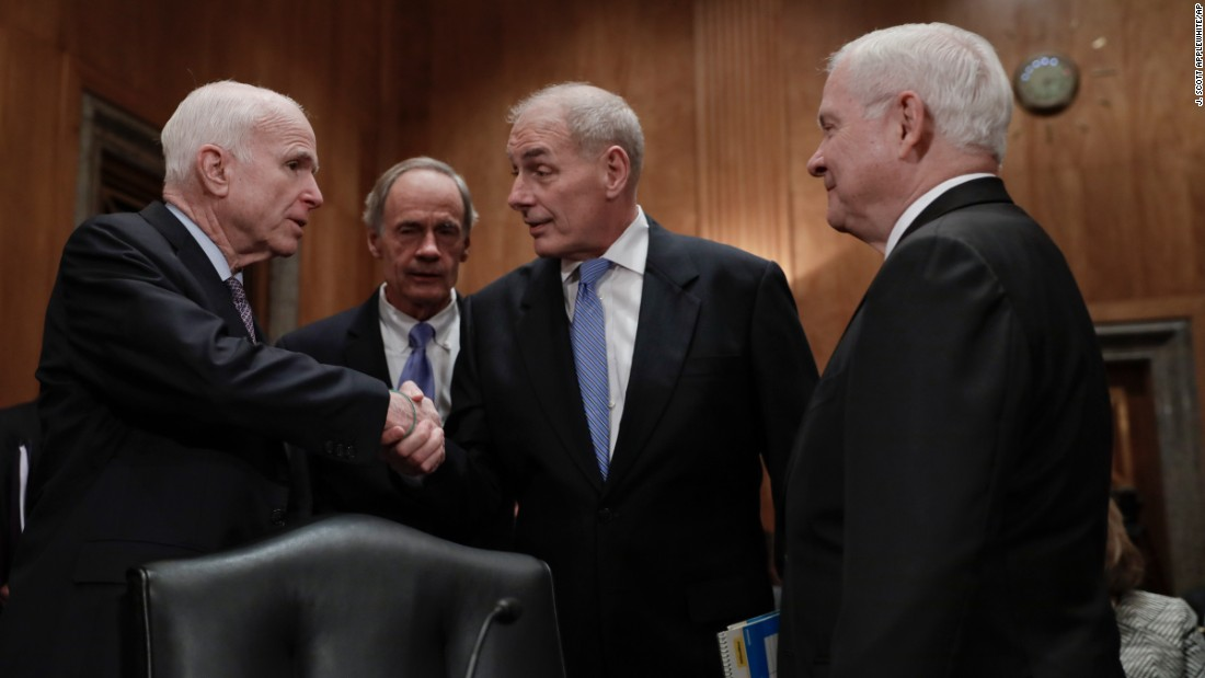 US Sen. John McCain, left, shakes hands with Kelly before the hearing. Former Defense Secretary Robert Gates is on the right. US Sen. Tom Carper is behind them.