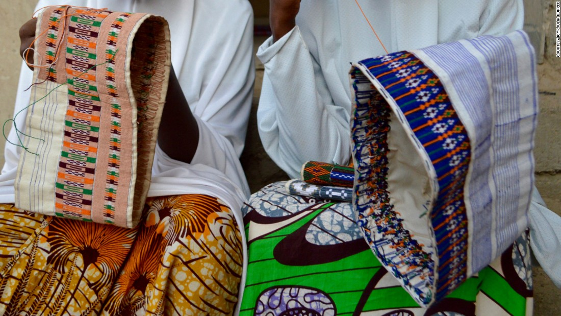"Others pass the time with embroidery. Fatmata (right), 22, was forced to flee at 5am on a Monday morning when Boko Haram attacked her village. ""They started shooting guns and killing people. We ran and ran through the bush and on Tuesday, we reached Maiduguri (about 80 km away),"" she told IOM."