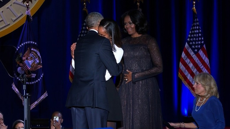 Obamas, Bidens take stage together