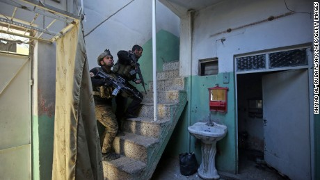 Members of the Iraqi special forces Counter Terrorism Service (CTS) clear a building  in eastern Mosul's on January 2, 2017. On Saturday Iraqi forces warned residents in the western part of the city with leaflets, that they're starting ground operations against ISIS there.