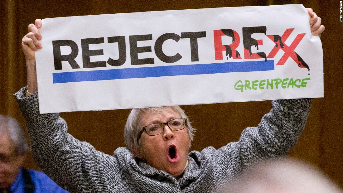 A protester holds a sign during Tillerson's hearing on January 11.