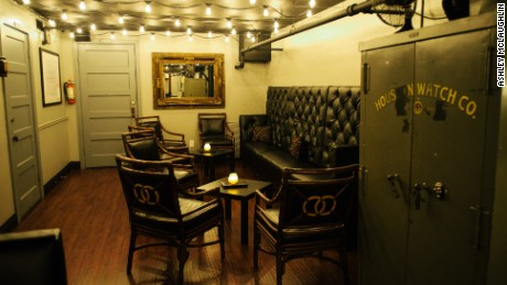 Safes from the space's life as a watch and jewelry shop are found throughout the bar.