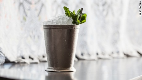 Classic mint juleps are served in cold nickel-plated cups.