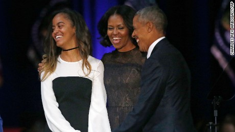 President Barack Obama, right, laughs as he is joined by First Lady Michelle Obama and daughter Malia Obama after giving his presidential farewell address at McCormick Place in Chicago, Tuesday, Jan. 10, 2017. (AP Photo/Charles Rex Arbogast)
