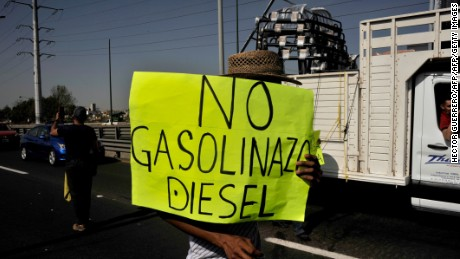 Activists block the Guadalajara-Mexico highway during a protest against the rise in fuel prices in Tlaquepaque, Jalisco state on January 3, 2017.  Mexicans angry about a steep hike in gasoline prices blocked roads around the country Monday, but the government refused to budge on the energy reform behind the increase. / AFP / HECTOR GUERRERO        (Photo credit should read HECTOR GUERRERO/AFP/Getty Images)