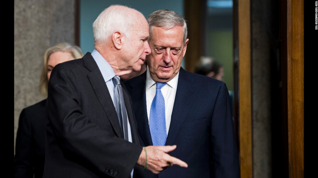 Mattis is escorted to his confirmation hearing by US Sen. John McCain, chairman of the Senate Armed Services Committee.