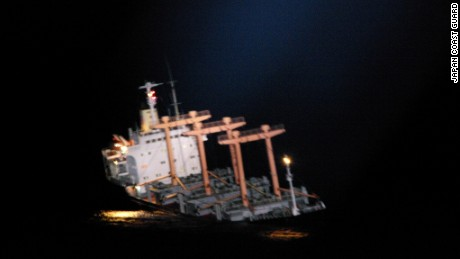 Blurry images show the ship listing.