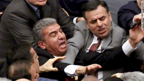 Ruling Justice and Development Party and main opposition Republican People's Party lawmakers scuffle at the parliament in Ankara during deliberations over a controversial 18-article bill to change the constitution to create an executive presidency January 11, 2017. Turkish lawmakers on Thursday approved three more articles in a hugely controversial bill bolstering the powers of President Recep Tayyip Erdogan, as lawmakers brawled and threw objects in a session of high tension. A brawl erupted in the chamber as the voting took place in an overnight session, with lawmakers punching each another and chairs being thrown, television pictures showed.  / AFP / -        (Photo credit should read -/AFP/Getty Images)