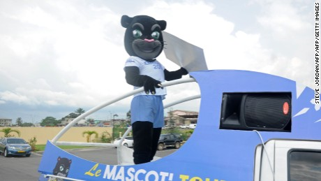 An entertainer dressed as Samba, the mascot of the 2017 African Cup of Nations, arrives to a ticket office as tickets for the football tournament go on sale in Nzang-Ayong, about 33 kms from Libreville, on December 15, 2016. Gabon insists it is ready to host the African Cup of Nations, running from January 14 to February 5 next year, despite concern about the state of preparations amid political instability just one month ahead of the opening ceremony. / AFP / Steve JORDAN        (Photo credit should read STEVE JORDAN/AFP/Getty Images)