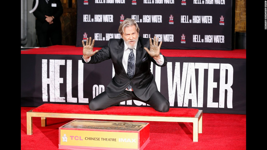 Actor Jeff Bridges leaves his handprints and footprints at the TCL Chinese Theatre in Hollywood on Friday, January 6.