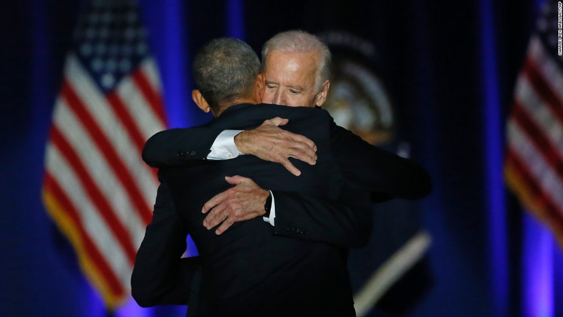 Obama hugs Biden after Obama gave his farewell address in Chicago on Tuesday, January 10.
