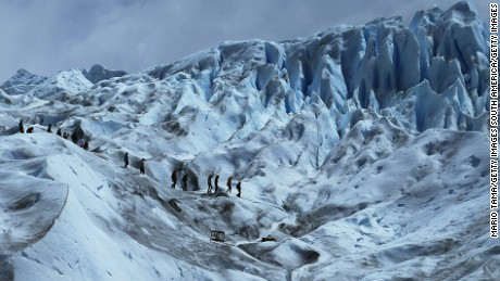 SANTA CRUZ PROVINCE, ARGENTINA - NOVEMBER 30:  People hike on the Perito Moreno glacier in Los Glaciares National Park, part of the Southern Patagonian Ice Field, on November 30, 2015 in Santa Cruz Province, Argentina.  The Southern Patagonian Ice Field is the third largest ice field in the world. The majority of the almost 50 large glaciers in Los Glaciares National Park have been retreating during the past fifty years due to warming temperatures, according to the European Space Agency (ESA). The United States Geological Survey (USGS) reports that over 68 percent of the world's freshwater supplies are locked in ice caps and glaciers. The United Nations climate change conference began November 30 in Paris.  (Photo by Mario Tama/Getty Images)