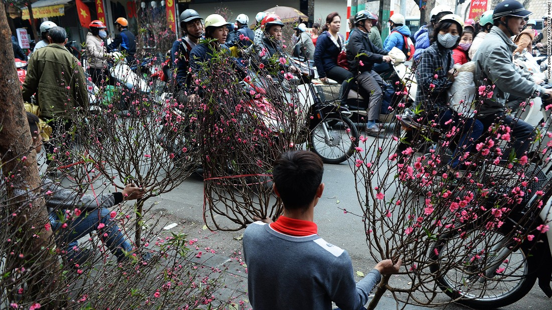 <strong>Hanoi, Vietnam -- Tet flower market: </strong>Known as Tet in Vietnam, Lunar New Year is the most important holiday in the country. Dodging motorcyclists while visiting a local flower market is part of the fun of celebrating the festival in Hanoi.