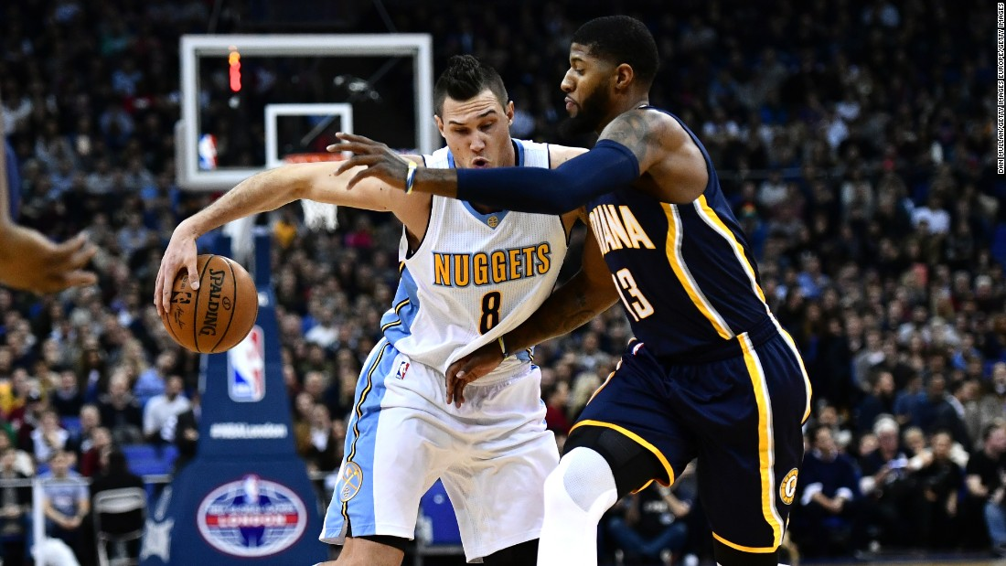 Denver's Danilo Gallinari holds off Paul George.