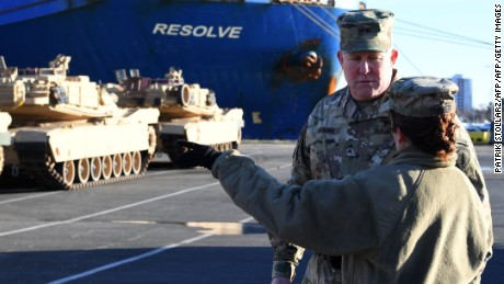 Maj. Gen. Timothy McGuire, deputy commander of US miltary in Europe, supervises the unloading of US military vehicles from a transport ship in the harbor in Bremerhaven, northwestern Germany.