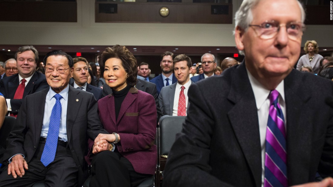 Chao sits with her father, James, before the start of her confirmation hearing. In the foreground is her husband, Senate Majority Leader Mitch McConnell.