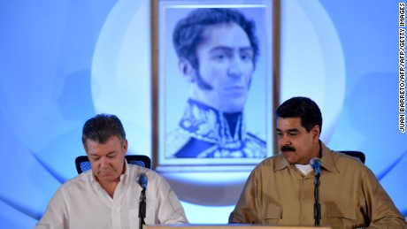"Colombian President Juan Manuel Santos (L) and Venezuelan President Nicolas Maduro take part in a meeting to discuss ending a row that has kept their border closed for nearly a year, on August 11, 2016 in Puerto Ordaz, some 650km southeast of Caracas.     The Colombian president's office said the two leaders would seek to ""normalize"" the situation along the border, which Maduro closed last year after an attack on a Venezuelan army patrol. / AFP / JUAN BARRETO        (Photo credit should read JUAN BARRETO/AFP/Getty Images)"