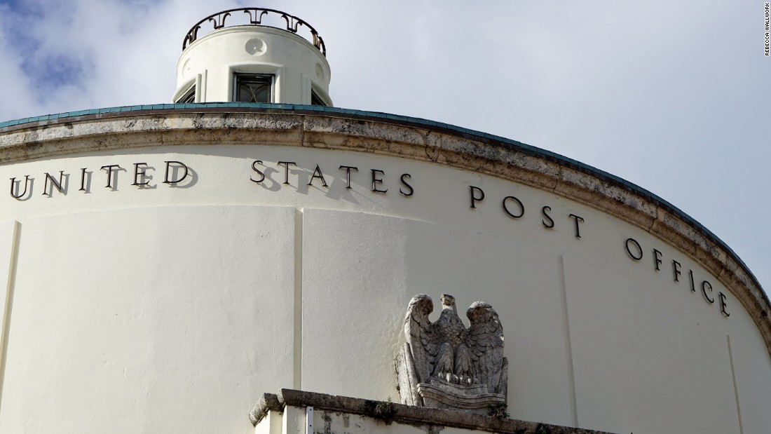Built in 1939, the interior of the rotunda of the Miami Beach United States Post Office still features decorative detail and murals from that time.