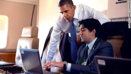 Former White House staff speechwriter Aneesh Raman works with President Obama aboard Air Force One in 2014.