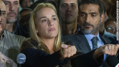 The wife of jailed opposition leader Leopoldo Lopez, Lilian Tintori (C), reacts during press conference in Caracas on September 10, 2015. Jailed Venezuelan opposition leader Leopoldo Lopez was sentenced to nearly 14 years in prison for inciting violence during deadly protests in 2014. The popular dissident, a US-trained economist who has been held at a military prison since February 2014, is accused of inciting violence against the government of President Nicolas Maduro and attempting to force his ouster. AFP PHOTO/ FEDERICO PARRA        (Photo credit should read FEDERICO PARRA/AFP/Getty Images)