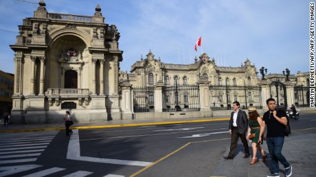 Pedestrians walk past the Presidential Palace in downtown Lima on November 17, 2016 as the city hosts the Asia-Pacific Economic Cooperation Summit. Top world leaders meet from November 18 to try to save their cherished free trade accords from feared extinction under US President-elect Donald Trump. / AFP / MARTiN BERNETTi        (Photo credit should read MARTIN BERNETTI/AFP/Getty Images)