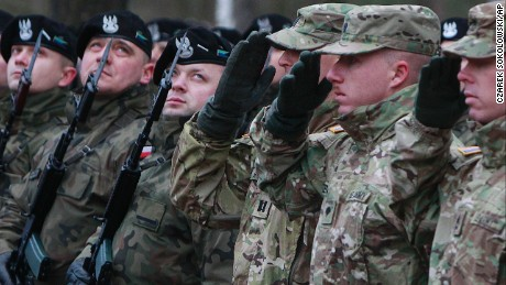 U.S. Army soldiers are welcomed in Zagan, Poland, Thursday, January 12, 2017. U.S. troops arrived at the Zagan base in western Poland as part of deterrence force of some 1,000 troops to be based here and reassure Poland that is worried about Russia's activity.