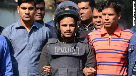 Bangladesh police escort alleged Islamist militant Jahangir Alam, in body armor, in Dhaka on January 14, 2017, after his arrest in connection with an attack on the Holey Artisan Bakery attack last year.