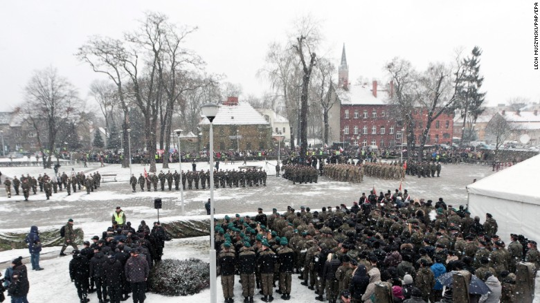 US and Polish troops participate in an official welcome event for the US army in Zagan, Poland, on January 14.