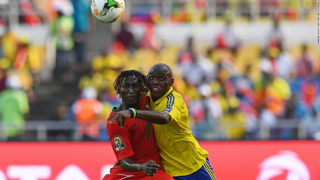 Guinea-Bissau's midfielder Zezinho (L) challenges Gabon's midfielder Merlin Tandjigora for possession in a closely fought first period that ended scoreless.