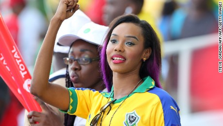 A Gabon supporter cheers during the 2017 Africa Cup of Nations group A football match between Gabon and Guinea-Bissau at the Stade de l'Amitie Sino-Gabonaise in Libreville on January 14, 2017. / AFP / Steve JORDAN        (Photo credit should read STEVE JORDAN/AFP/Getty Images)