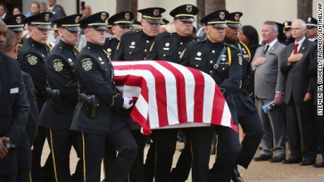 The flag-draped casket is carried to the hearse during funeral services for Orlando Police Master Sgt. Debra Clayton at the First Baptist Church in Orlando on Saturday, Jan. 14, 2017. Clayton, who was gunned down was remembered Saturday at her funeral service as someone who put everyone at ease with her infectious smile and made every effort to bridge the gap between law enforcement and the community it served. (Stephen M. Dowell/Orlando Sentinel via AP)