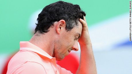 Rory McIlroy cannot mask his disappointment after losing a playoff on the 18th green at the South African Open to Graeme Storm.