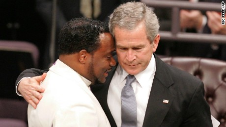 President George Bush hugs Bishop Eddie Long during Coretta Scott King's 2006 funeral.