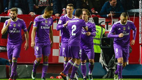 Real Madrid's Cristiano Ronaldo (3rdL) celebrates after putting his side ahead against Sevilla.