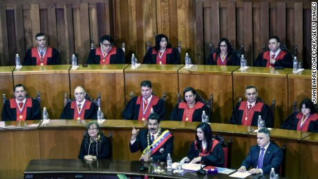 Venezuelan President Nicolas Maduro (C) delivers a speech reviewing his year in office at the Supreme Court of Justice in Caracas on January 15, 2017. Venezuela's leader Nicolas Maduro angered his opponents Sunday by refusing to deliver his annual presidential address in the legislative chamber, fanning tensions in the volatile country.  / AFP / JUAN BARRETO        (Photo credit should read JUAN BARRETO/AFP/Getty Images)