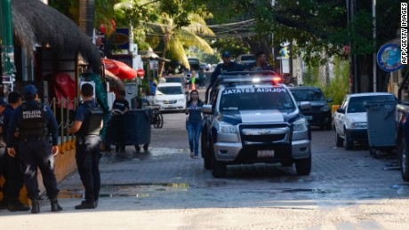 Mexican police agents patrol near a nightclub in Playa del Carmen, Quintana Ro state, Mexico where 5 people were killed, three of them foreigners, during a music festival on January 16, 2017.