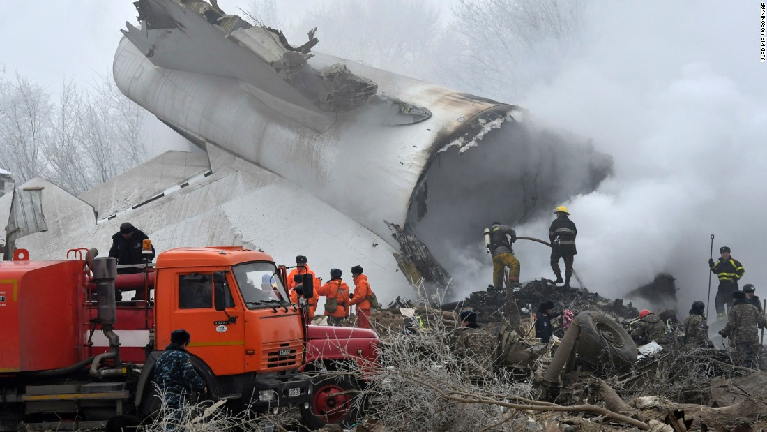 Emergency responders work amid the debris of a Turkish Boeing 747 cargo plane that crashed into a village outside Bishkek, Kyrgyzstan, on Monday, January 16. Dozens were killed in the crash, including people on the plane and residents of the area adjacent to Manas airport where the plane crashed.