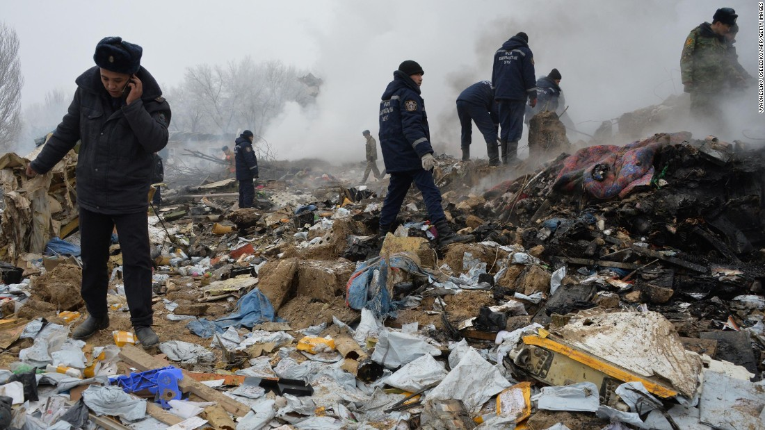 Rescue workers comb through debris at the site of the crash. The Boeing 747 was traveling from Hong Kong to Kyrgyzstan's capital, Bishkek, according to data from the tracking website FlightRadar24.