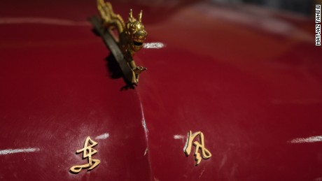In the 1950s the lettering on bonnets of these Dongfeng cars were changed from pinyin to Chinese characters, because Mao Zedong couldn't read the former.