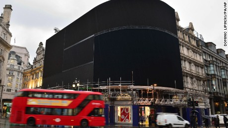The advertising screens at Piccadilly Circus, central London, after they were switched off in preparation for redevelopment Monday Jan.  16, 2017. The iconic lights have gone out so that the electronic hoardings can be replaced with a state-of-the-art screen measuring 790 square metres which is expected to be unveiled in the autumn. (Dominic Lipinski/PA via AP)