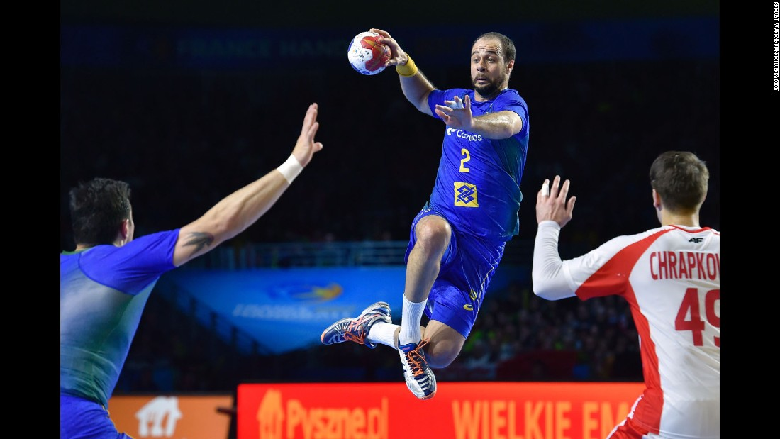 Brazil's center back Henrique Teixeira passes the ball during the 25th IHF World Men's Handball Championship  match against Poland on January 14.