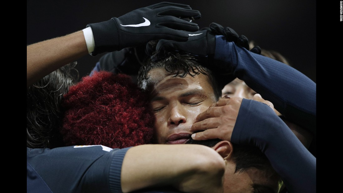 Thiago Silva of Paris Saint Germain is surrounded by his teammates after scoring against FC Metz during the French Coupe de la Ligue quarter final soccer match on January 11. The goal gave Paris Saint Germain a 2-0 lead.