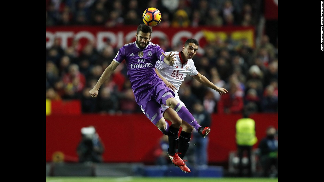 Nacho Fernandez of Real Madrid, left, competes for the ball with Wissam Ben Yedder of Sevilla during the La Liga match at Estadio Ramon Sanchez Pizjuan on January 15, in Seville, Spain.