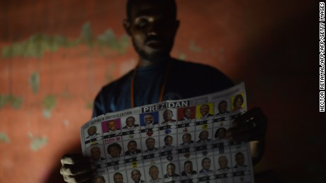 TOPSHOT - Election officials count ballots at a polling station in the Roger Ladoceur School in the commune of Delmas in the Haitian capital Port-au-Prince, on November 20, 2016 during the presidential and legislative elections.  Haitians cast their ballots for president and members of the legislature in elections that had been delayed for more than a year by a constitutional crisis. Nearly 6.2 million people are eligible to vote in the impoverished Caribbean country, parts of which are still struggling to recover from a devastating hurricane.  / AFP / HECTOR RETAMAL        (Photo credit should read HECTOR RETAMAL/AFP/Getty Images)