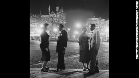 The lights were blacked out during World War II but by the time this picture of American troops and their girlfriends was taken in 1955, the area was vibrantly-lit again.