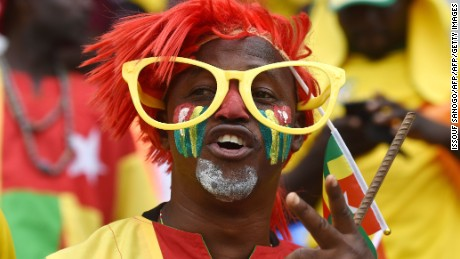 A Togo supporter cheers for his team ahead of the 2017 Africa Cup of Nations group C football match between Ivory Coast and Togo in Oyem on January 16, 2017. / AFP / ISSOUF SANOGO        (Photo credit should read ISSOUF SANOGO/AFP/Getty Images)