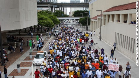 "MIAMI - AUGUST 28:  People march in an event organized by the local chapter of the National Association for the Advancement of Colored People protesting what they say are persistent inequities in employment and economic status August 28, 2007 in Miami, Florida.  The march also coincided with the 44th anniversary of Martin Luther King Jr.'s famous ""I Have a Dream"" speech in Washington, DC.  (Photo by Joe Raedle/Getty Images)"