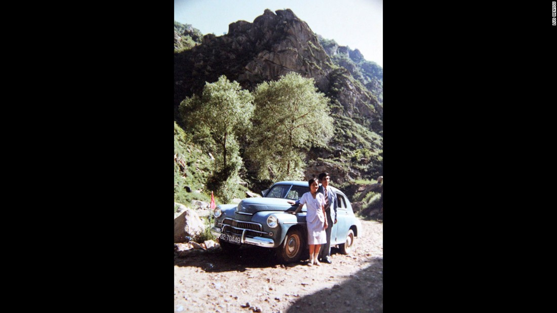 It was rare to be a private car owner in China in the late 1970s, when he purchased this vehicle. Here, Luo Wenyou and his wife pose with his first car.